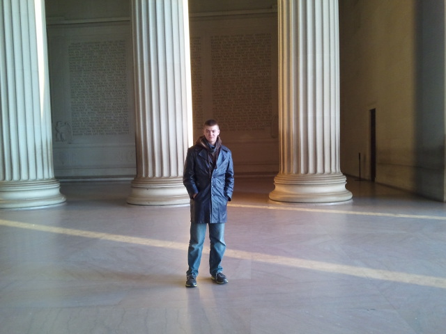 Dylan at Lincoln Memorial pillars with sunrise streaming in
