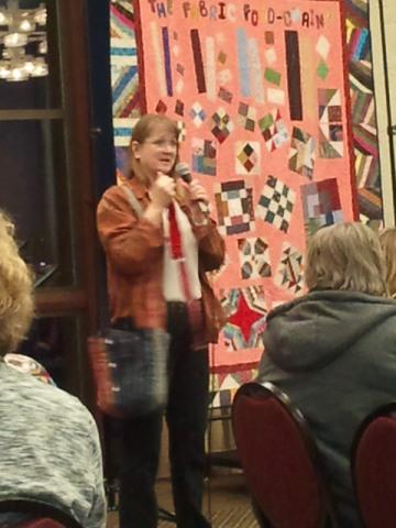 Bonnie giving night presentation
