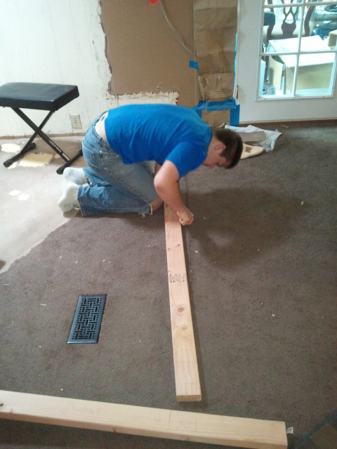 Dylan measuring to frame