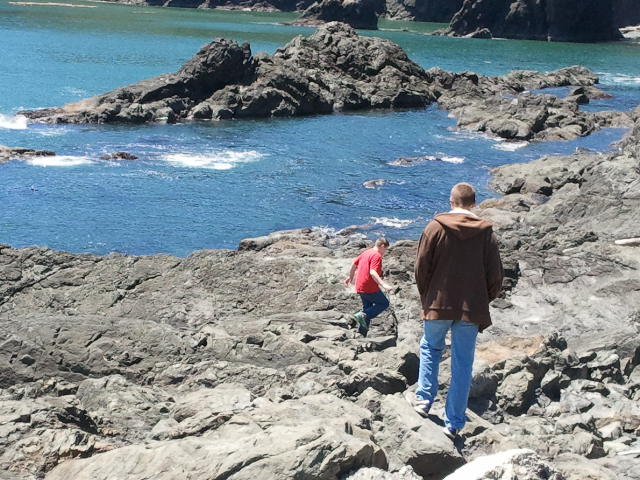 Both boys in rocks