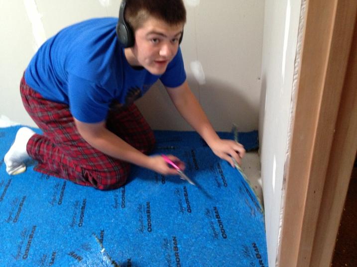 dylan laying carpet