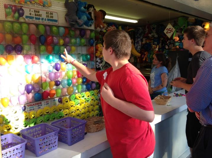 Ben throwing at balloons