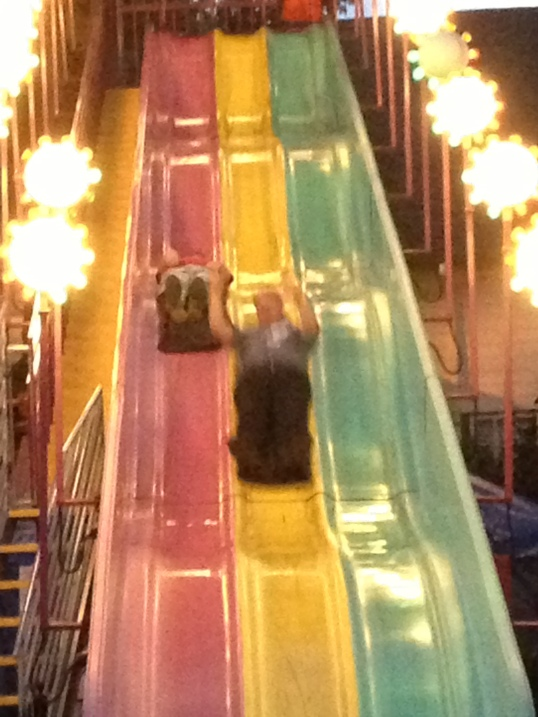 Ben and Doug going down the big slide