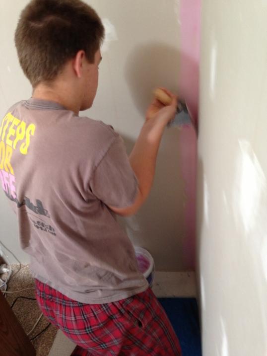 Dylan spackling his room